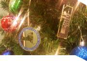 the NYG&B ornament hangs from a holiday tree